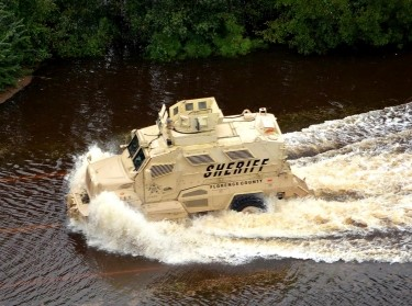A mine-resistant, ambush-protected vehicle was used to extract people day and night from flooded areas in Florence County, North Carolina