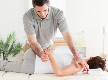 Chiropractor adjusting a female patient