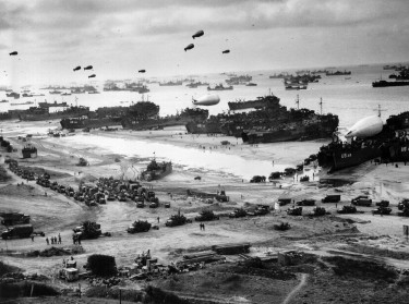 Landing ships putting cargo ashore on Omaha Beach, mid-June, 1944