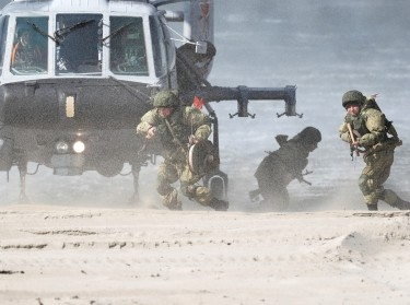 Servicemen disembark from a Ka-29 helicopter during an exercise staged by the Baltic Fleet forces of the Russian Navy to train amphibious assault, at Khmelevka firing ground in Kaliningrad Region, Russia, April 4, 2019, photo by Vitaly Nevar/Reuters