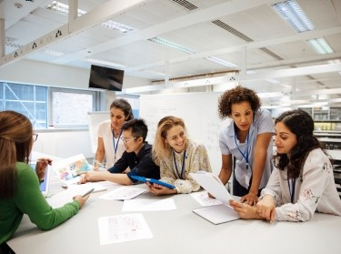 A group of teachers looking at data, photo by SolStock/Getty Images