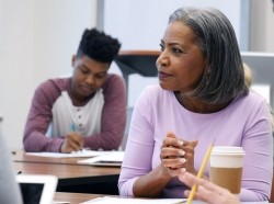 Educator listens during a parent-teacher conference, photo by SDI Productions/Getty Images