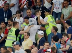 Fans are escorted out by stewards after fighting in the stands at the Croatia vs. Denmark World Cup Round of 16 match at Nizhny Novgorod Stadium, Russia, July 1, 2018