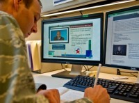 Air Force Maj. Michael Odle, Defense Department assistant director of military compensation policy, reviews the DoD course content for the Blended Retirement System opt-in training at the Pentagon, Jan. 30, 2017