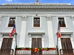 The Municipal Government Building of San Juan, Puerto Rico, built in the colonial style, photo by demerzel21/Getty Images