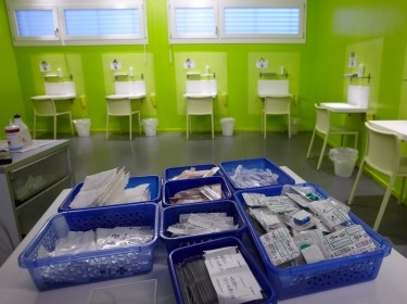 Kits of supplies containing syringes, bandaids, and antiseptic pads in a safe injection site called Quai 9 near Geneva main train station, Switzerland, October 14, 2010