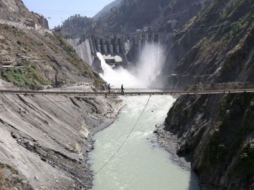 Laborers walk on a bridge near the 450-megawatt hydropower project at Baglihar Dam on the Chenab river which flows from Indian Kashmir into Pakistan, October 10, 2008
