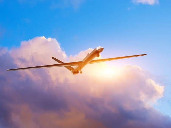Unmanned military drone on patrol air territory, gaining heights to determine goals, photo by aapsky/ Getty Images/iStockphoto