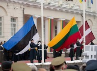 Flags of Estonia, Lithuania, and Latvia are raised in a ceremony outside the presidential palace in Vilnius, Lithuania, during the country's centenary celebration, February 16, 2018