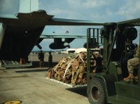 A U.S. Marine with Special Purpose Marine Air-Ground Task Force-Crisis Response-Africa 19.1 loads equipment onto a U.S. Marine Corps KC-130 at Naval Air Station Sigonella, Italy, Dec. 13, 2018. SPMAGTF-CR-AF is deployed to conduct crisis-response and theater-security operations in Europe and Africa, photo by Cpl. Bethanie Ryan/U.S. Marine Corps
