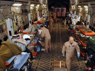 Members of an Expeditionary Aeromedical Evacuation Squadron monitor patients during an aero-medical evacuation mission from Balad Air Base, Iraq, to Ramstein Air Base, Germany, February 25, 2007, photo by MSgt. Scott Reed/U.S. Air Force