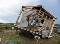 Juan Negron prepares to start up a power generator in front of what's left of his damaged property after Hurricane Irma, in the island of Culebra, Puerto Rico, September 7, 2017, photo by Carlos Giusti/AP Photos