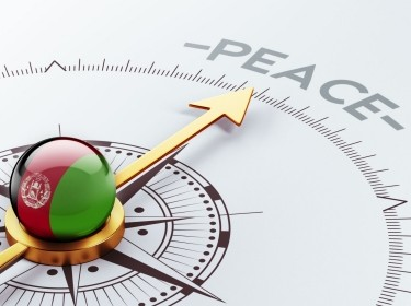 A compass pointing toward peace for Afghanistan, photo by XtockImages/Getty Images