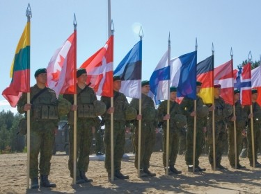 Soldiers represent their nation's flags during the opening ceremony of Saber Strike 2015 held in Pabrade, Lithuania, June 8, 2015, photo by Sgt. James Avery/U.S. Army