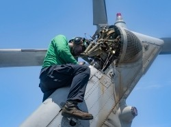 Aviation mechanic works on a Sea Hawk helicopter