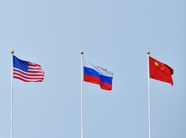Flags of the United States, Russia, and China in the sky, photo by Pridannikov/Getty Images