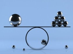 Balance board with chrome spheres of varied sizes, photo by akinbostanci/Getty Images