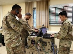 U.S. Army 1st Lt. Shaun Lawson, Cpl. Marvin Carson and Sgt. John Delgado, assigned to Charlie Company, 44th Expeditionary Signal Battalion, 2nd Theater Signal Brigade, manage the company network operations (NETOPS) cell monitoring the networks at exercise Allied Spirit VIII, Jan. 30, 2018 at the Hohenfels Training Area, Germany, photo by William B. King/U.S. Army