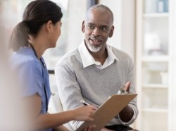 Older gentleman talks with a female doctor, photo by SDI Productions/Getty Images