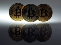 Mock Bitcoins are displayed in Berlin, January 7, 2014