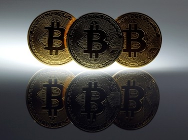 Mock Bitcoins are displayed in Berlin, January 7, 2014, photo by Pawel Kopczynski/Reuters