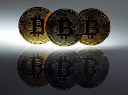 Mock Bitcoins are displayed in Berlin, January 7, 2014, photo by Pawel Kopczynski/Reuters