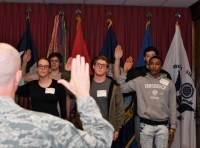 U.S. Brig. Gen. Jonathan Ellis delivers the oath of enlistment to 10 Army and Navy recruits during a swear-in ceremony at the MEPS in Shreveport, Louisiana, Feb. 27, 2018