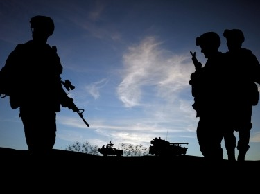 Silhouette of soldiers with military vehicles, photo by veneratio/Adobe Stock