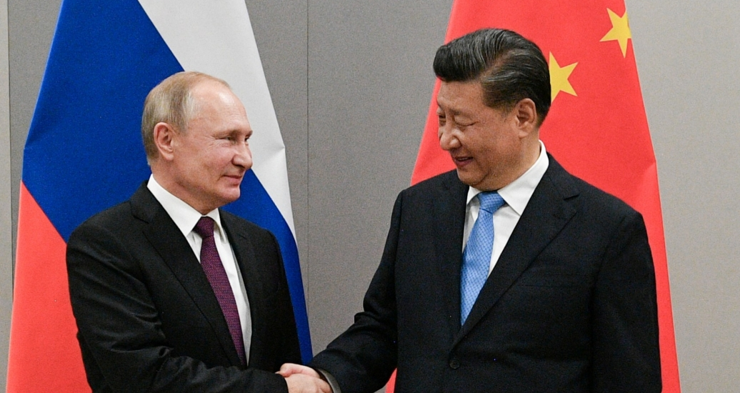 Russian President Vladimir Putin shakes hands with Chinese President Xi Jinping during their meeting on the sidelines of a BRICS summit, in Brasilia, Brazil, November 13, 2019