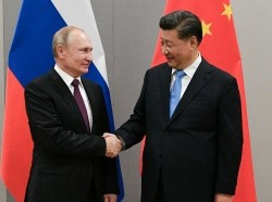 Russian President Vladimir Putin shakes hands with Chinese President Xi Jinping during their meeting on the sidelines of a BRICS summit, in Brasilia, Brazil, November 13, 2019, photo by Ramil Sitdikov/Sputnik via Reuters