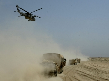 A U.S. Army medical helicopter flies over the Army's 3rd Infantry division's convoy on its push towards Baghdad, Iraq, April 3, 2003, photo by Kai Pfaffenbach/Reuters