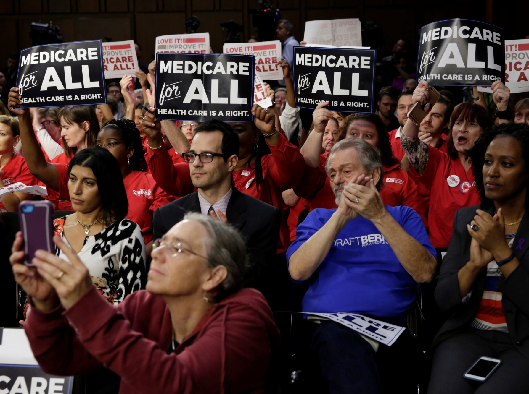 """Supporters of a """"Medicare for All"""" plan gather on Capitol Hill in Washington, D.C., September 13, 2017, photo by Yuri Gripas/Reuters"""