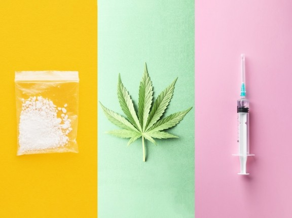 Cocaine, cannabis leaf, and syringe, photos by Bits and Splits, underworld, and Leonid/Adobe Stock