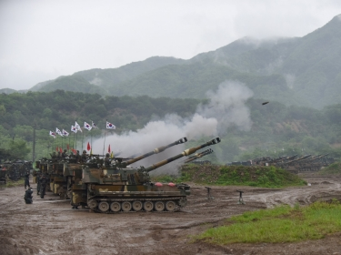 South Korean soldiers coordinate fires during a joint artillery exercise with U.S. soldiers near the Demilitarized Zone that separates North and South Korea, May 10, 2016, photo by Staff Sgt. Keith Anderson/U.S. Army