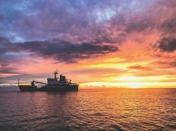 Coast Guard cutter Cypress at sunset. Photo by Petty Officer 3rd Class Lora Rat / U.S. Coast Guard