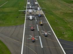 Nine U.S. Coast Guard aircraft sit on a runway at Manassas Regional Airport, June 17, 2016.