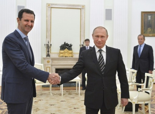 Russian President Vladimir Putin shakes hands with Syrian President Bashar al-Assad during a meeting at the Kremlin in Moscow, Russia, October 20, 2015