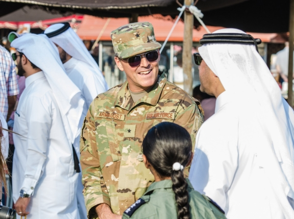 U.S. Air Force Brig. Gen. Jason Armagost, commander of the 379th Air Expeditionary Wing, talks with a Qatari Emiri Air Force dignitary at the Qatar Emiri Air Force Family Cultural Exchange at Al Udeid Air Base, Qatar, Dec. 1, 2017. The cultural exchange, hosted by the QEAF, was a relationship building event that gave families and members of Qatari, U.S. and coalition forces an opportunity to interact and learn about each others cultures. The event included cultural exhibits, regional animals, local food, games for children and more, photo by Staff Sgt. Patrick Evenson/U.S. Air National Guard