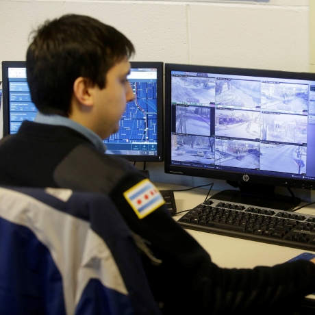 A Chicago police officer monitors the Police Observation Devices on computer screens at the 7th District police station in Chicago, Illinois, January 5, 2018, photo by Joshua Lott/Reuters