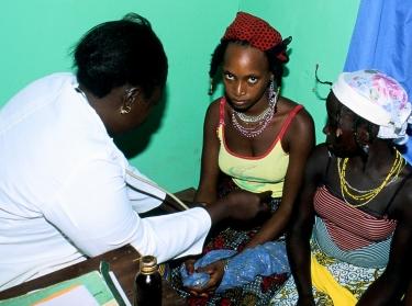 Nigerian women receive health checkup at clinic