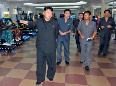 North Korea's leader Kim Jong-un visits a newly built arcade at the amusement house of the Rungna People's Pleasure Park