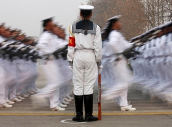 Chinese People's Liberation Army Navy recruits march during a parade in Qingdao, Shandong province, December 5, 2013