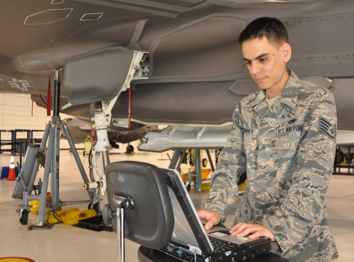 Staff Sgt. Matthew Stormer reviews joint technical data while performing tasks to maintain the joint strike fighter July 25, 2013.