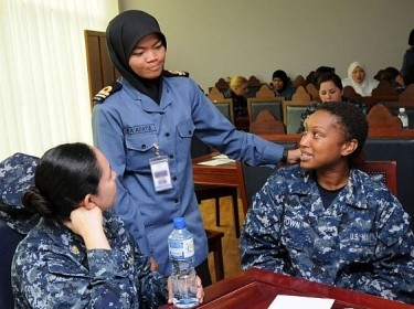 USS Dewey (DDG 105) Fire Controlmen Speak with a Royal Brunei Navy officer During CARAT