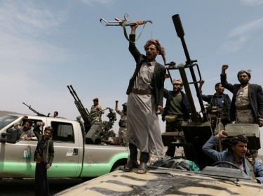 Houthi fighters during a gathering of Houthi loyalists on the outskirts of Sanaa, Yemen, July 8, 2020, photo by Khaled Abdullah/Reuters