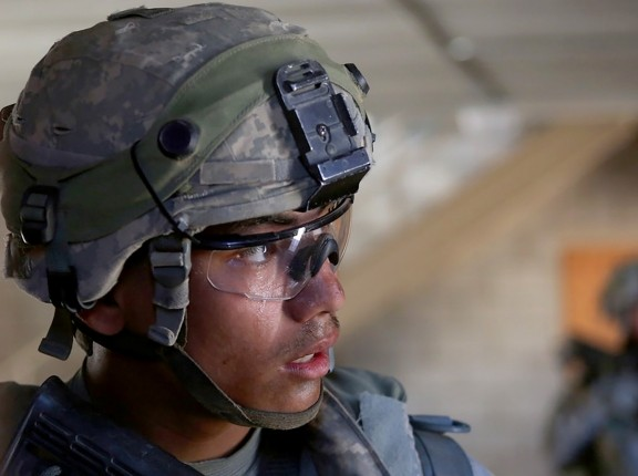 U.S. Army specialist in a door-to-door exercise at the National Training Center, Fort Irwin, California, June 20, 2014, photo by Spc. Charles Probst/U.S. Army