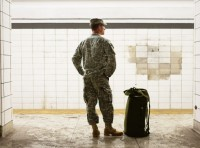 A soldier is waiting for the train, photo by PeopleImages/Getty Images
