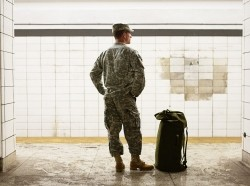 A soldier is waiting for the train, photo by MivPiv/Getty Images/iStockphoto