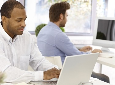 two men working in a bright office