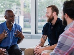 African-American man sharing during group therapy session, photo by SDI Productions/Getty Images